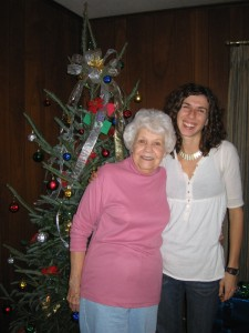 My grandmother and I in front of her real Christmas tree last year...